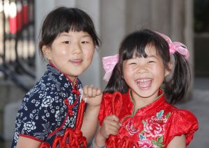 Mary He (6) and Helena Liu (5) at the Festival of Peoples. Pic John Mc Elroy.