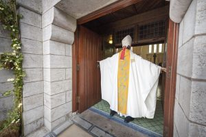 Archbishop Charles Brown crosses the threshold of the Door of Mercy on Lough Derg. Pic: Michael Mc Laughlin.
