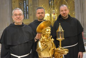 Franciscan Conventual friars, Fr Mario, Fr Valentin and Fr Lucian in St Patrick's Cathedral with one of two relics of St Anthony.