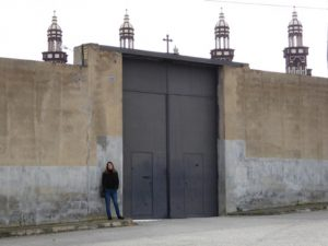 Maria Hall stands outside entrance to Palmerian headquarters at Palmar de Troya, Spain.