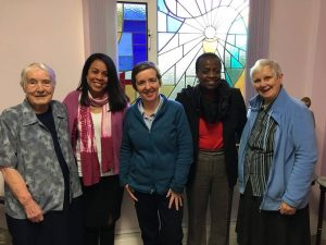 CEO Heydi Foster, and Learning and Development Officer Colette Nkunda with Sisters Louis-Marie O'Connor, Rowena Galvin, and Eileen McGrath from the Sisters of St. Joseph of Cluny.