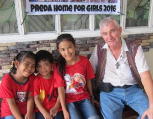 FR SHAY CULLEN WITH SOME OF THE PREDA SCHOOL CHILDREN