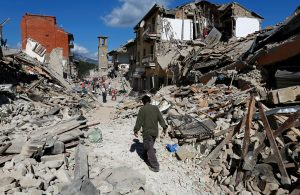 A man walks amidst rubble following an earthquake in Pescara del Tronto, central Italy, August 24, 2016. REUTERS/Remo Casilli TPX IMAGES OF THE DAY - RTX2MTHB