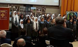 Pupils from Clonskeagh Mosque primary school sing a welcome to President Higgins.