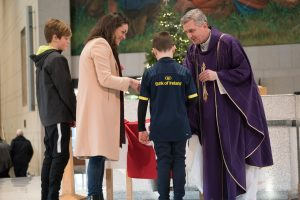 18/12/2016 The family of Anthony Foley his wife Olive and her sons Tony, 11 and Dan, 8 present a Munster Rugby Jersey to Fr. Richard Gibbons, at Knock Shrine, Knock, Co. Mayo. Photo : Keith Heneghan / Phocus