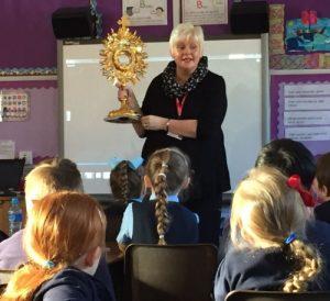 Antoinette Moynihan explains adoration to children in Scotland.